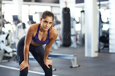 Buy stock photo Cropped portrait of a young woman looking tired after a solid workout