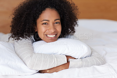 Buy stock photo Portrait of a young woman lying in her bed