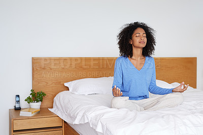 Buy stock photo Shot of a young woman meditating in her bedroom