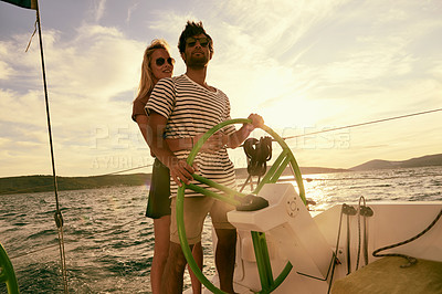 Buy stock photo Shot of an affectionate couple on a yacht