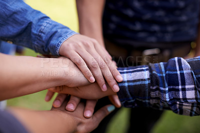 Buy stock photo Closeup shot of a group of friends with their hands together in unity