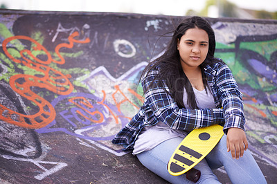 Buy stock photo Portrait of a young skateboarder at a skatepark
