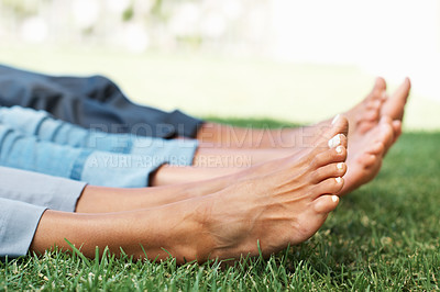 Buy stock photo Closeup of relaxed feet of a family lying on grass