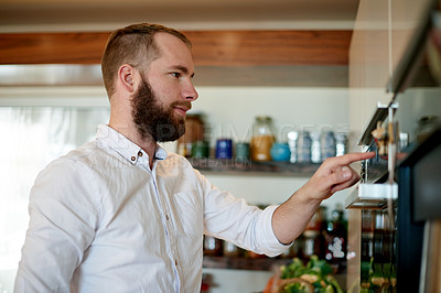 Buy stock photo Shot of a young man cooking at home