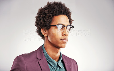 Buy stock photo Cropped shot of a young man wearing glasses against a gray background
