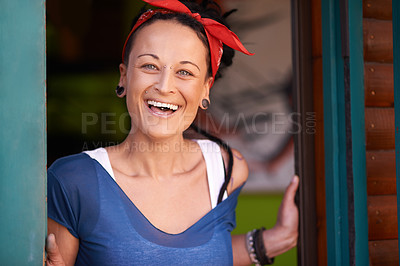 Buy stock photo Portrait of a young woman with dreadlocks laughing at home