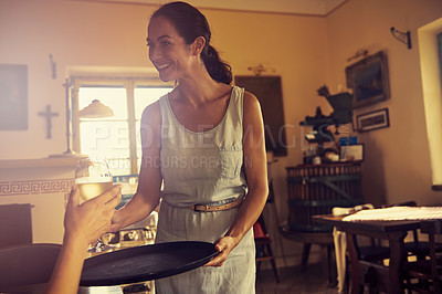 Buy stock photo Shot of a woman serving someone in her restaurant