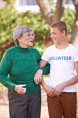 Buy stock photo Shot of a young volunteer worker with a senior woman