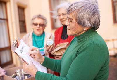 Buy stock photo Cropped shot of a senior woman signing up for something