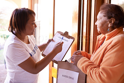 Buy stock photo Cropped shot of a volunteer doing charity work at a nursing home