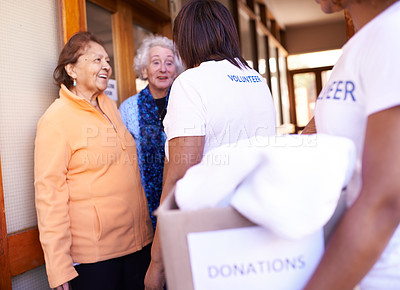 Buy stock photo Cropped shot of volunteers bringing donations to senior citizens in need