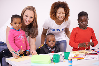 Buy stock photo Cropped shot of volunteers working with children