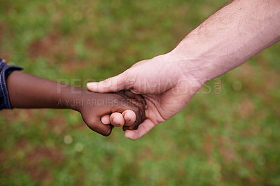 Buy stock photo Cropped shot of a man's hand holding a child's