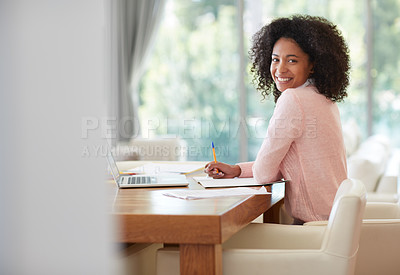 Buy stock photo Cropped portrait of a young woman working at home