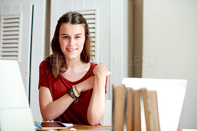 Buy stock photo Shot of a teenage girl sitting at her study desk