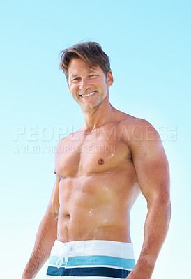 Buy stock photo Portrait of sweaty muscular man standing against sky and smiling