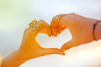 Buy stock photo Cropped shot of a woman making a heart shape with her hands