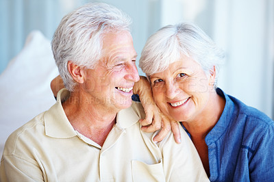 Buy stock photo Closeup portrait of senior man and woman sitting together and smiling