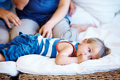 Buy stock photo Young kid lying on sofa with thumb in mouth