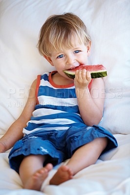 Buy stock photo Portrait of cute kid relaxing on sofa and eating a piece of watermelon