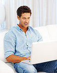 Surprised man using laptop