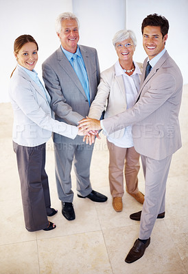 Buy stock photo Portraot of a group of business colleagues with their hands piled on top of one another