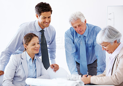 Buy stock photo Group of businesspeople working togther on a new project at meeting