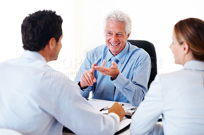Buy stock photo Portrait of a experienced financial consultant explaining investment plans to his client in office