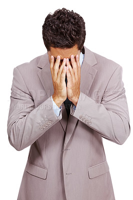 Buy stock photo Disappointed businessman hiding his face with hands against white background