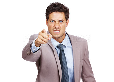 Buy stock photo Portrait of an angry young business man in suit pointing at you isolated over white background