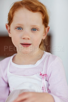 Buy stock photo Closeup portrait of an innocent little redheaded girl giving you a cute smile
