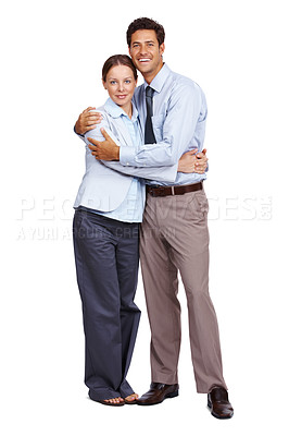 Buy stock photo Full length of romantic young business couple hugging eachother over white background