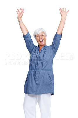 Buy stock photo Portrait of an excited old woman standing with her arms raised in air isolated against white background