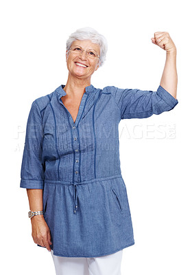 Buy stock photo Portrait of a happy female senior citizen showing her muscles isolated against white background