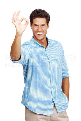 Buy stock photo Portrait of a handsome young man smiling and gesturing okay sign against white background