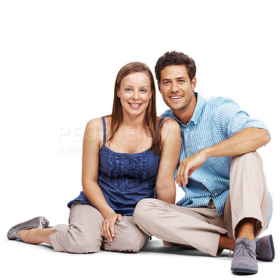 Buy stock photo Portrait of a beautiful young couple sitting together isolated over white background
