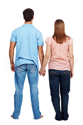 Buy stock photo Rear view of a young couple holding their hands isolated over white background