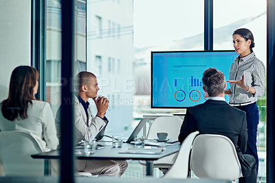Buy stock photo Cropped shot of a businessperson delivering a presentation in the boardroom
