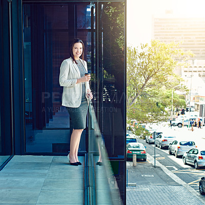Buy stock photo Portrait of a young businesswoman having a coffee break at work