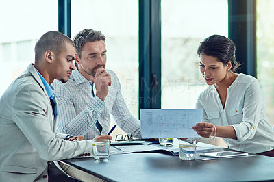Buy stock photo Shot of colleagues having a meeting in an office
