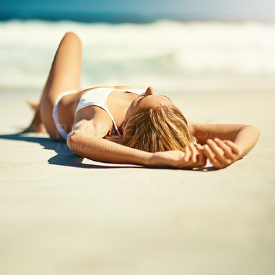 Buy stock photo Full length shot of a beautiful young woman lying on the beach