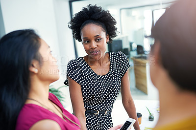 Buy stock photo Cropped shot of three businesswomen meeting in the boardroom