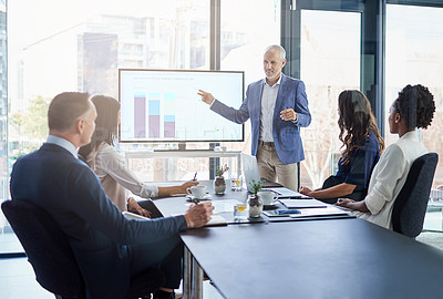 Buy stock photo Cropped shot of a businessman giving a presentation in a boardroom