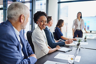 Buy stock photo Portrait of a businesswoman sitting in a boardroom presentation with colleagues