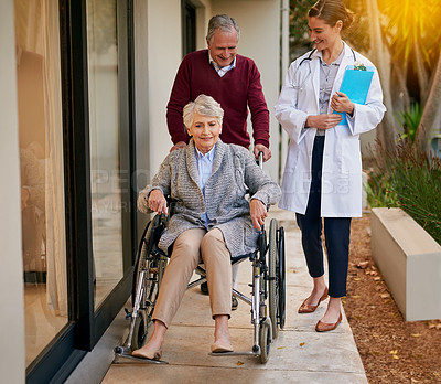 Buy stock photo Shot of a senior couple and a nurse outside a nursing home