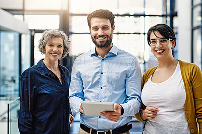 Buy stock photo Portrait of a group of creatives working together on a digital tablet in an office