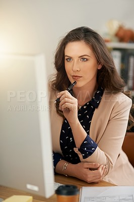Buy stock photo Cropped shot of a young businesswoman working on a computer in a modern office