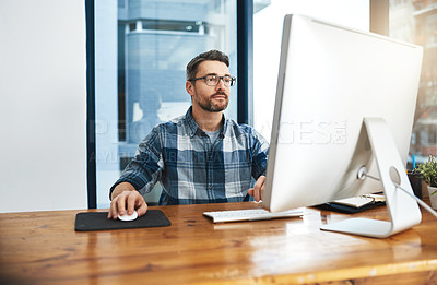 Buy stock photo Cropped shot of a businessman working on his computer in the office