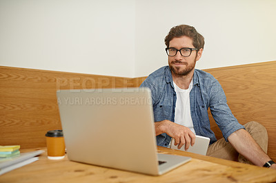 Buy stock photo Cropped portrait of a young man working on his laptop