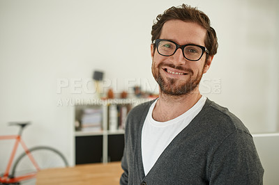 Buy stock photo Portrait of a confident young entrepreneur standing in his office